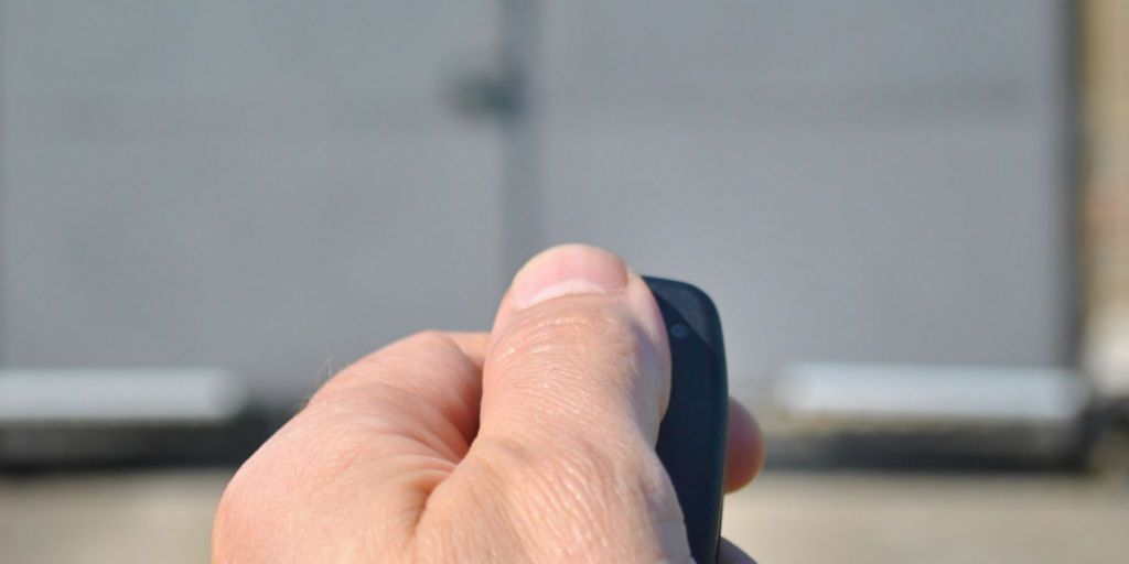 Hand using automatic gate opener